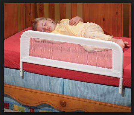 child behind a mes bed rail